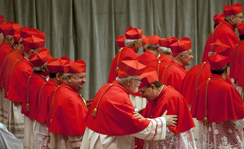 Cardinal Burke gives the sign of peace to Cardinal O'Malley