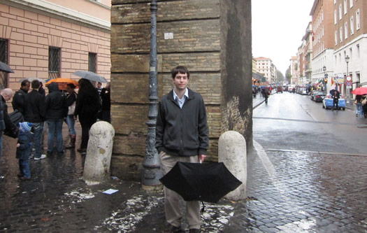 Jeff Geerling standing on Sanpietrini pavers outside of St. Peter's square
