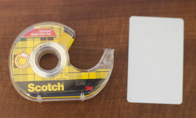 Double-sided tape and a credit card
