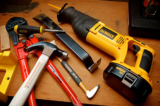 Tools for wrecking - reciprocating saw, hammer, prybar, bolt cutter, screwdriver