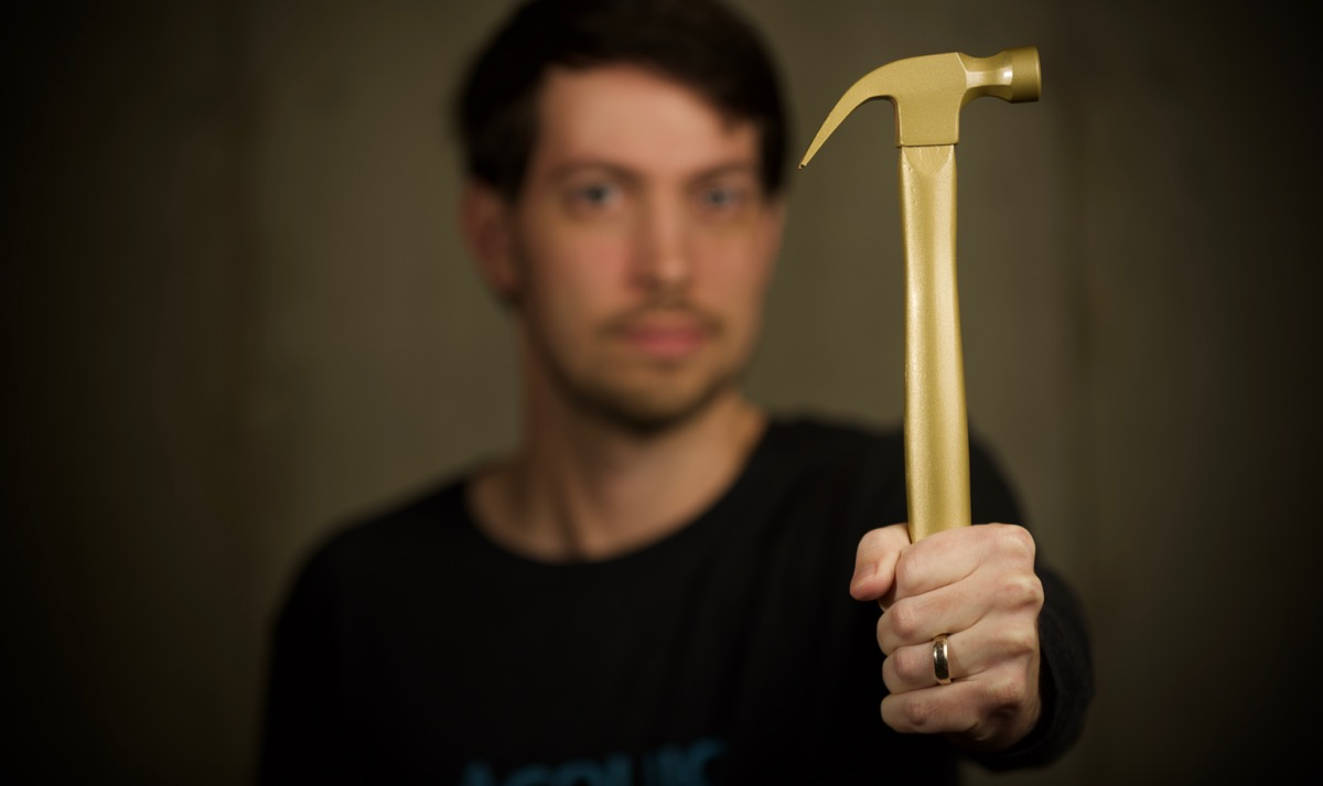 Jeff Geerling holding a golden hammer