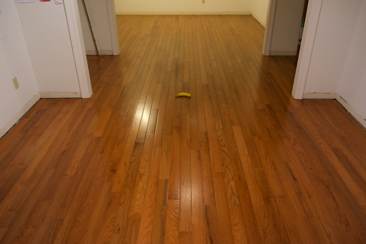 Flooring project completion of wood laying with banana for scale
