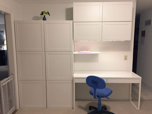 Functional wall with Ikea BESTÅ storage system after