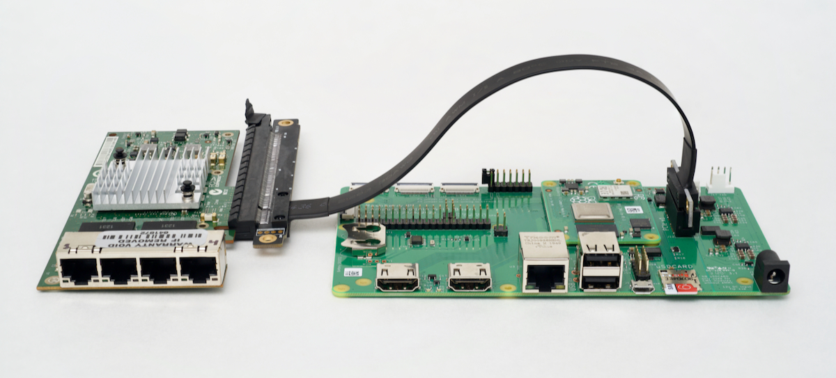 Intel I340-T4 plugged into Raspberry Pi Compute Module 4 IO Board with 16x to 1x adapter
