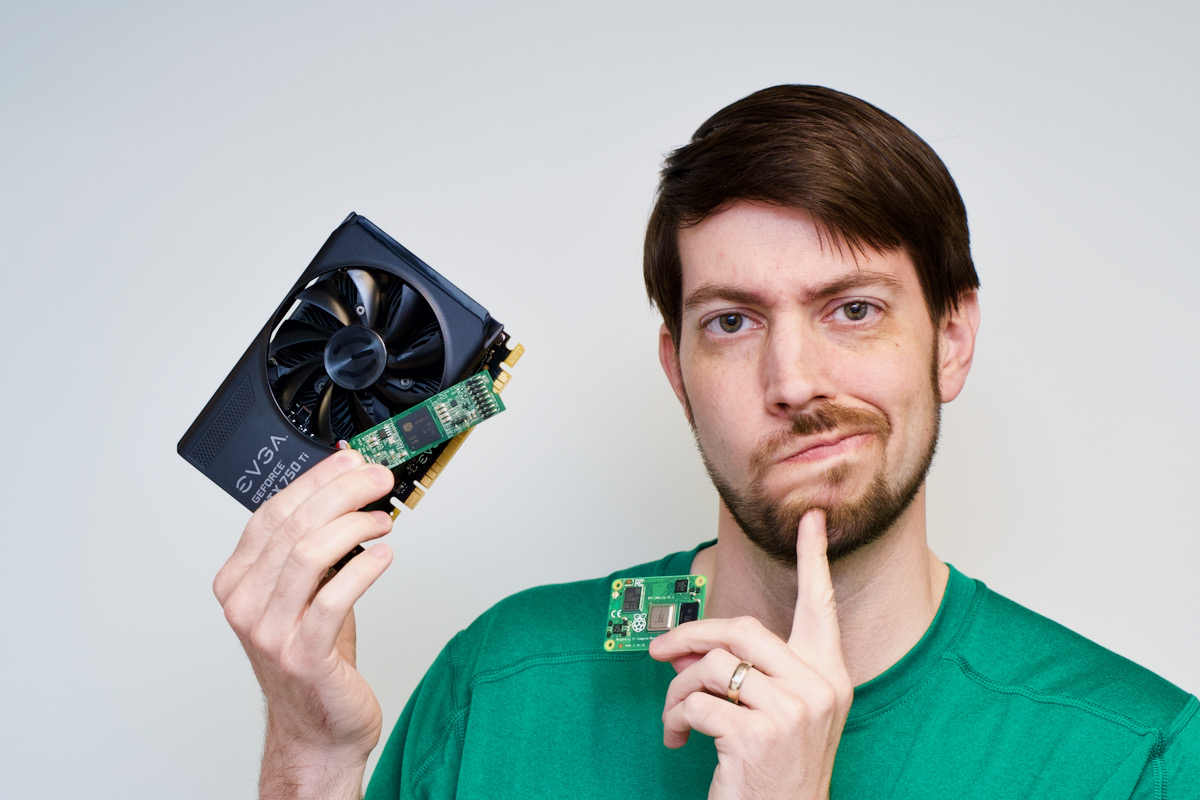 Jeff Geerling holds NVidia and ASRock Rack GPU and Raspberry Pi Compute Module 4 with quizzical look