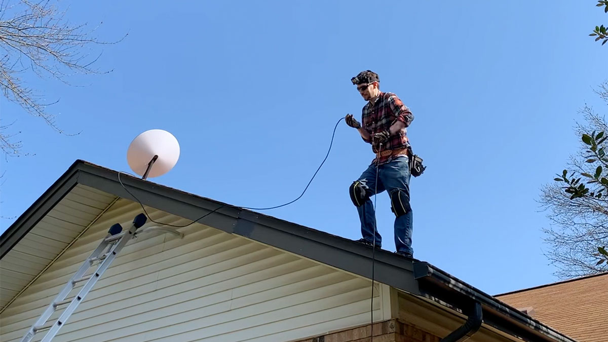 jeff installing Dishy on his roof in St. Louis MO