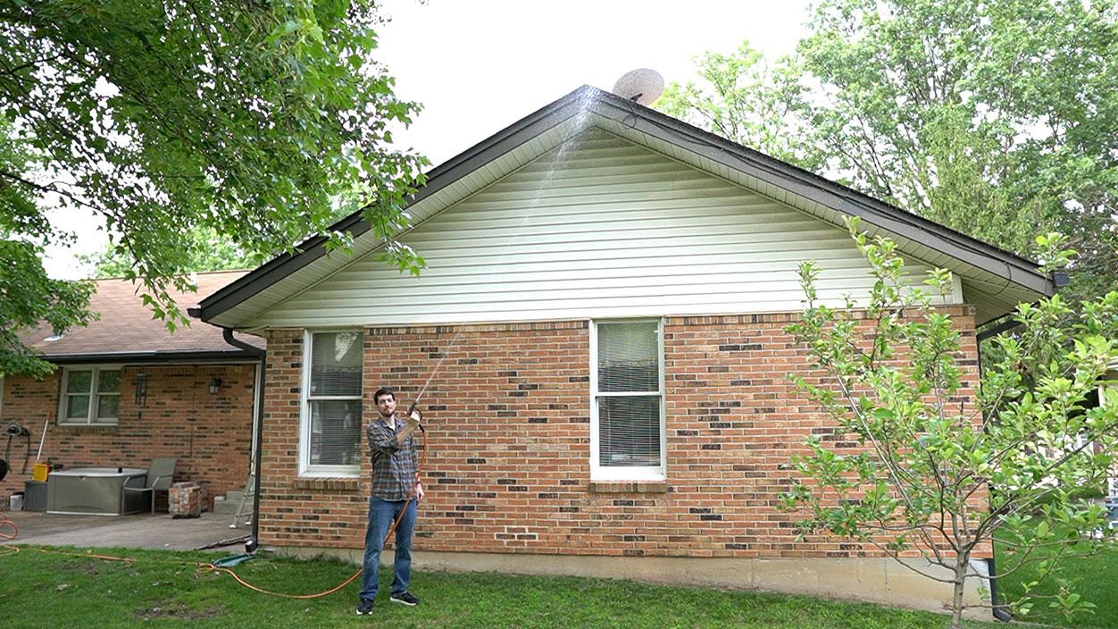 Jeff Geerling waters Dishy on roof - Starlink Satellite Internet