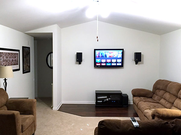 Fireplace and brick chimney DIY removal picture - after with media wall
