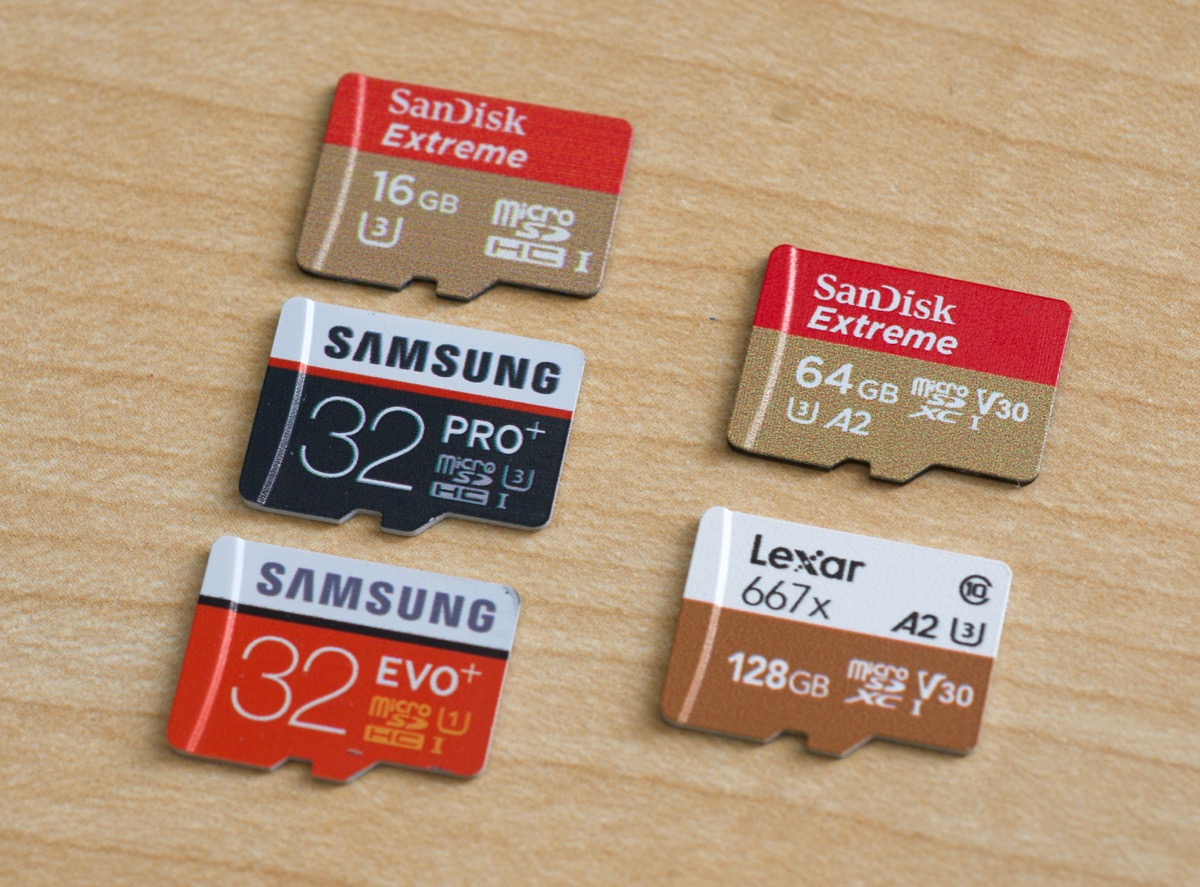 A2 Performance Class SanDisk and Lexar microSD cards next to older Samsung and SanDisk cards